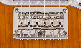 SIX-SADDLE STRINGS-THRU-BODY BRIDGE
