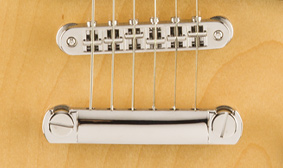 ADJUSTABLE BRIDGE WITH STOP TAILPIECE