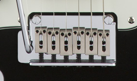 Six-Saddle Synchronized Tremolo with Block Saddles